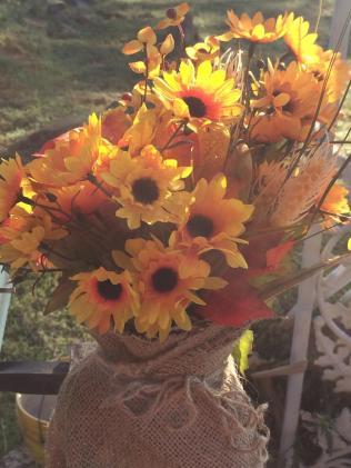 Fall flowers in burlap vase
