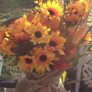 Fall flowers in burlap vase
