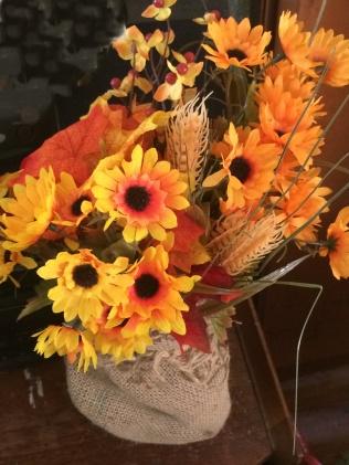 flowers in burlap vase 2